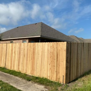 Installing a new wood fence in Greenville, Texas